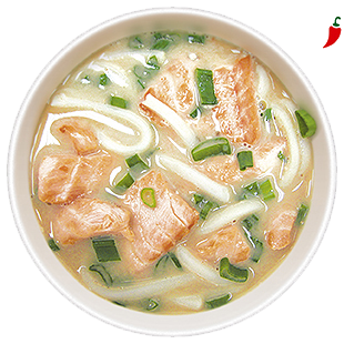 Spicy soup with fried salmon